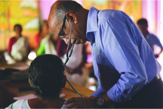 Dr Rajagopal examining a patient