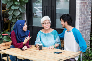 Series of young Malay couple with elderly women having conversation over coffee